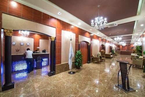 廣場旅館套房飯店