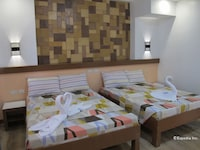 Deluxe Studio, Pool View, Corner (3 double beds and 1 double mattress)