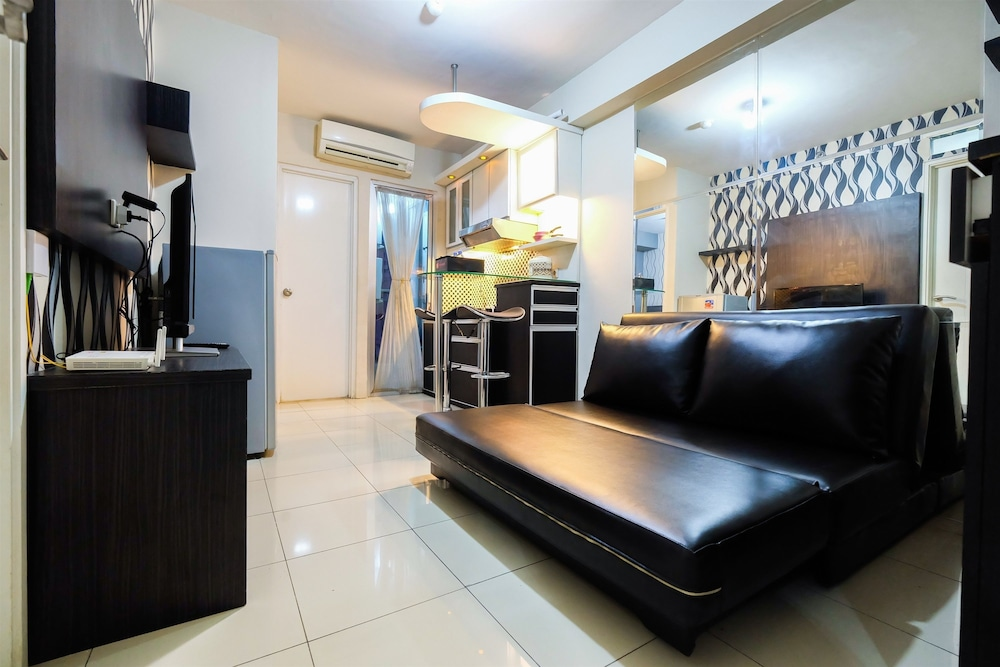 Monochrome Style 2 Bedrooms at Kalibata City Apartment By Travelio