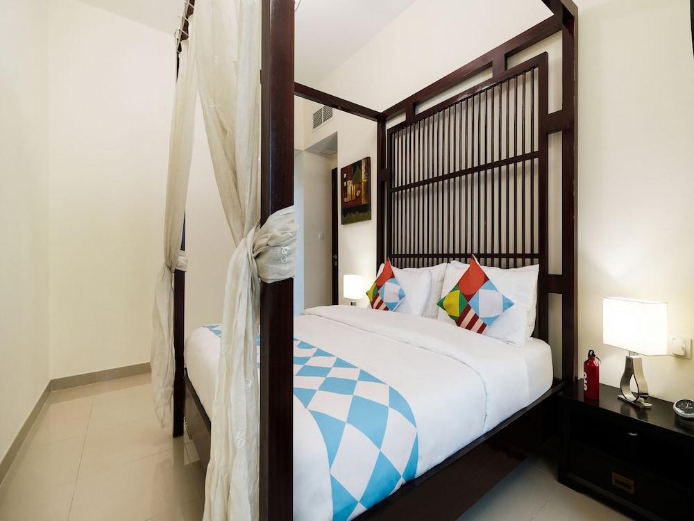 OYO 233 Home Marina Suites